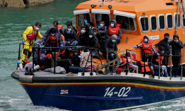Following a small boat incident, a group of illegal immigrants are onboard a lifeboat in Dover, Kent, on July 4, 2021. (Gareth Fuller/PA)