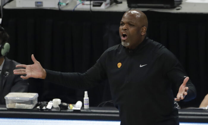 Atlanta Hawks' head coach Nate McMillan reacts to a call during the first half of Game 5 of the NBA Eastern Conference Finals in Milwaukee, Wis., on July 1, 2021. (Aaron Gash/AP Photo)