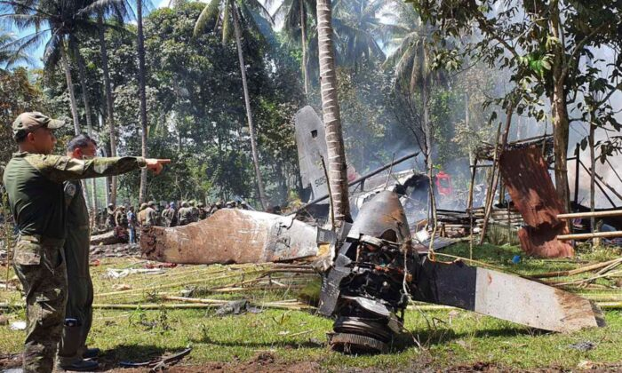 Parts of a Lockheed C-130 Hercules plane are seen at the crash site in Patikul town, Sulu province, southern Philippines, on July 4, 2021. (Joint Task Force-Sulu via AP)