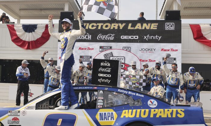 Chase Elliott celebrates his victory in a NASCAR Cup Series auto race Sunday, July 4, 2021, at Road America in Elkhart Lake, Wis. (AP Photo/Jeffrey Phelps)