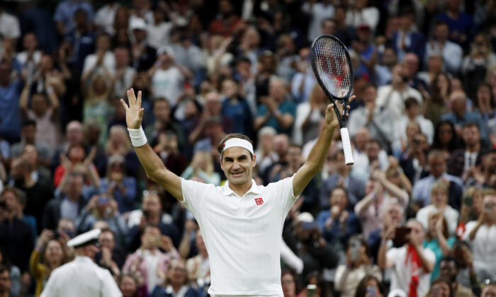 Switzerland's Roger Federer celebrates winning his fourth round match against Italy's Lorenzo Sonego at the Wimbledon Tennis Championships at the All England Lawn Tennis and Croquet Club in London, UK, on July 5, 2021. (Paul Childs/Reuters)