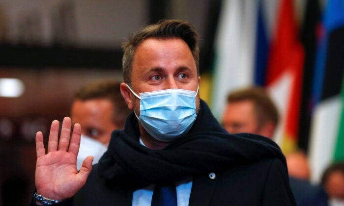 Luxembourg's Prime Minister Xavier Bettel leaves at the end of the first day of an EU summit in Brussels on June 25, 2021.  (Aris Oikonomou/Pool Photo via AP)