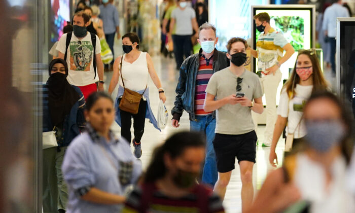 Shoppers wearing facemasks inside a shopping centre in East London on July 4, 2021. (Victoria Jones/PA)