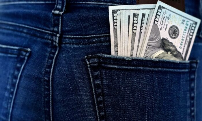 U.S. currency is seen in a back pocket in a file photo. (Timothy A. Clary/AFP via Getty Images)