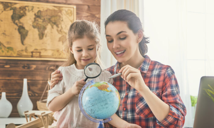 Having a map or globe around sparks curiosity. (Yuganov Konstantin/Shutterstock)