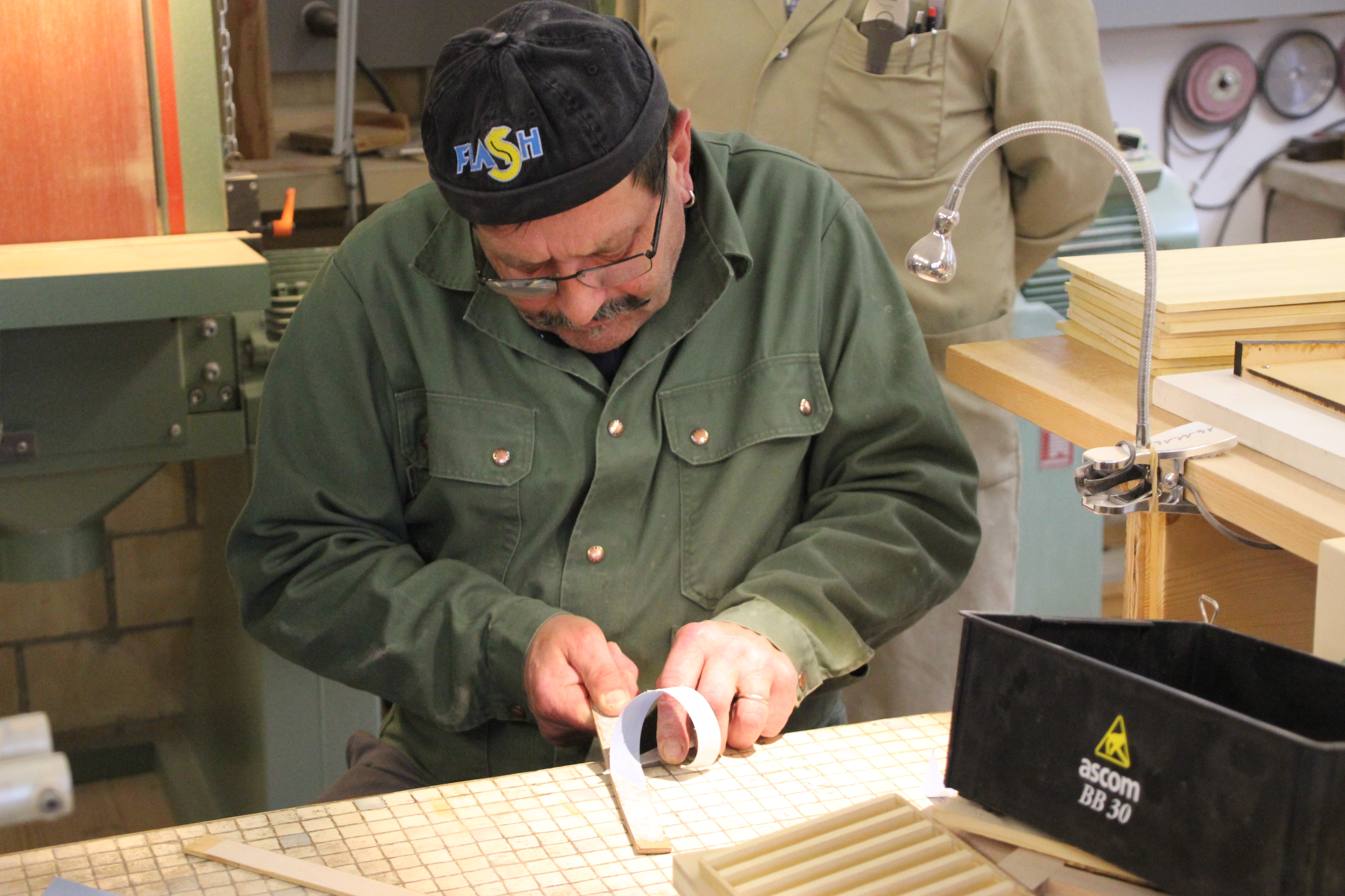 staff member cutting wood copyright Wibke Carter
