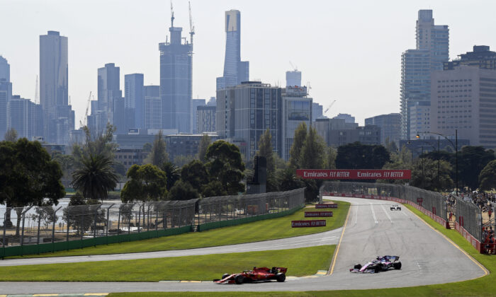 Formula One cars race on the circuit during the final practice session for the Australian Grand Prix in Melbourne, Australia, on March 16, 2019. (Andy Brownbill/AP Photo)