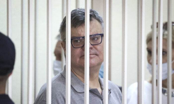 Viktor Babariko, the former head of Russia-owned Belgazprombank, stands inside a cage in a court room in Minsk, Belarus, on July 6, 2021. (Ramil Nasibulin/AP)