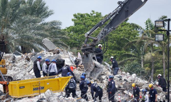 Search-and-rescue efforts resume the day after the managed demolition of the remaining part of Champlain Towers South complex in Surfside, Fla., on July 5, 2021. (Marco Bello/Reuters)