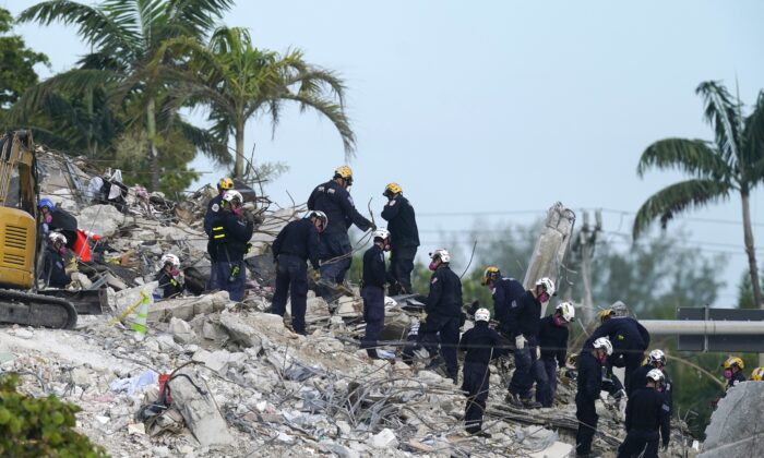 Rescue crews work at the site of the collapsed Champlain Towers South condo building after the remaining structure was demolished Sunday, in Surfside, Fla., on July 5, 2021. (Lynne Sladky/AP Photo)