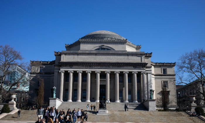 People walk on the Columbia University campus in New York City, on March 9, 2020. (Jeenah Moon/Getty Images)
