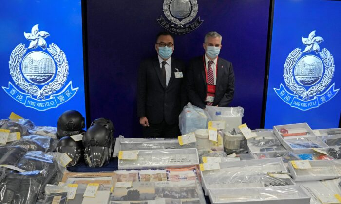 Senior Superintendent Li Kwai-wah (L) of Hong Kong Police National Security Department, and senior bomb disposal officer Alick McWhirter (R) of Explosive Ordnance Disposal Bureau, pose  during a news conference regarding nine people arrested over an alleged plot to plant bombs around Hong Kong, at the police headquarters in Hong Kong, on July 6, 2021. (Kin Cheung/AP Photo)