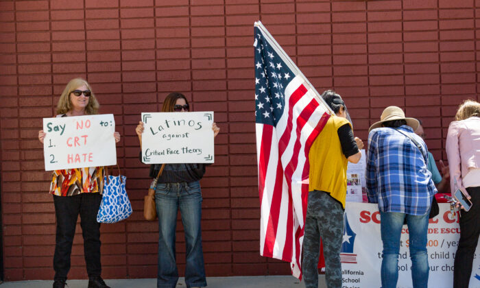 Demonstrators gather in front of Los Alamitos Unified School District Headquarters in protest of critical race theory teachings in Los Alamitos, Calif., on May 11, 2021. (John Fredricks/The Epoch Times)
