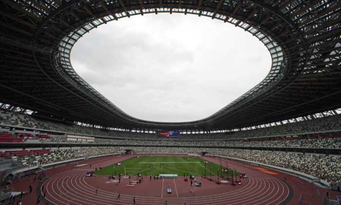 Athletes compete in the men's 400-meter T20 race during an athletics test event for Tokyo 2020 Paralympics Games at National Stadium in Tokyo, on May 11, 2021. (Shuji Kajiyama/AP Photo)