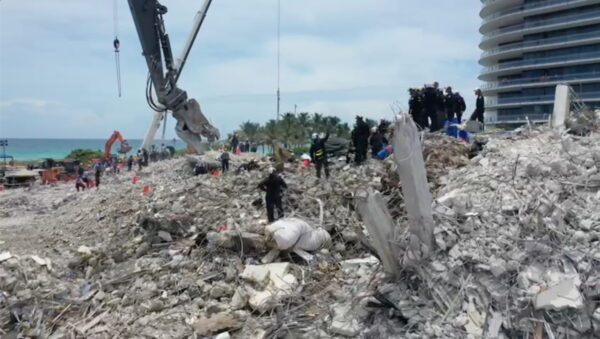 Search-and-rescue crew personnel on the debris of the collapsed Champlain Towers