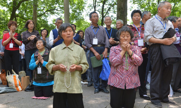 Catholics pray at Our Lady of Sheshan Basilica Catholic church in Shanghai, China, on May 24, 2013. (Peter Parks/AFP via Getty Images)