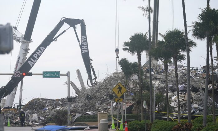 Rescue crews work in the rubble of the collapsed Champlain Towers South condominium building in Surfside, Fla., on July 6, 2021. (Lynne Sladky/AP Photo)