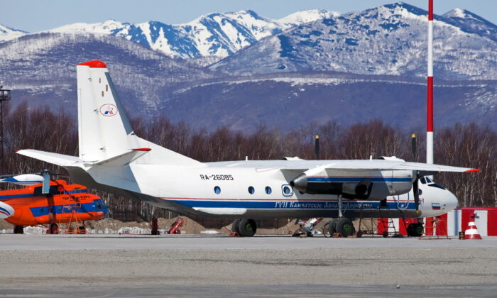 Russian An-26 plane with the tail number RA-26085 is seen in Petropavlovsk-Kamchatsky, Russia, in this undated handout image, on July 6, 2021. (Russia's Emergencies Ministry/Handout via Reuters)