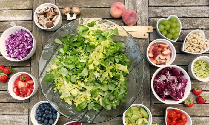 A salad with vegetables, fruits and nuts is seen in this stock photo. (Pixabay)