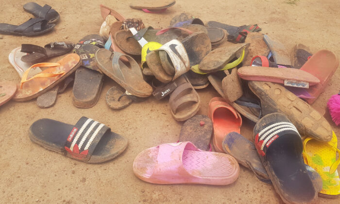 Shoes of abducted boarding school students lie on the floor after about 150 boarding students of Bethel Baptist School were kidnapped by gunmen in Kaduna, northwestern Nigeria, on July 5, 2021. (Kehinde Gbenga/AFP via Getty Images)