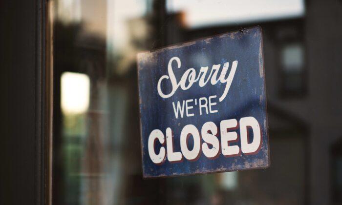 Closed store front. (Tim Mossholder / Unsplash)