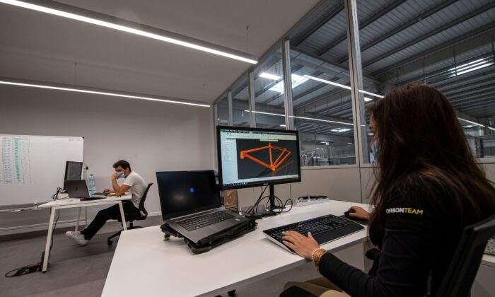 A designer use software to design the carbon fibre bike frame at Carbon Team factory in Vouzela, Portugal on July 2, 2021. (Octavio Passos/Getty Images)