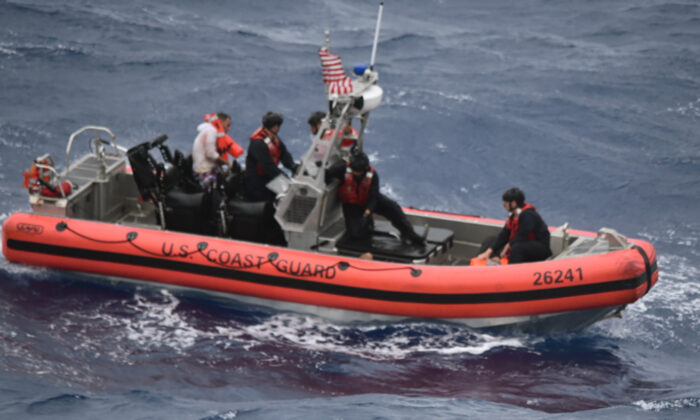 The Coast Guard Cutter Thetis' crewmembers deploy the cutter's small boat to rescue people in the water approximately 32 miles southeast of Key West, Fla., on Tuesday, July 6, 2021. (U.S. Coast Guard via AP)