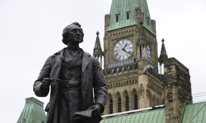 A statue of former Prime Minister Sir John A. Macdonald is pictured on Parliament Hill in Ottawa on June 3, 2021. (The Canadian Press/Sean Kilpatrick)