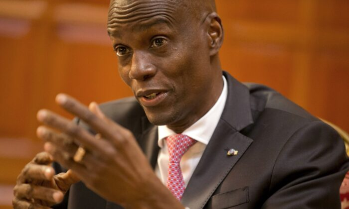 Haiti's President Jovenel Moise speaks during an interview at his home in Petion-Ville, a suburb of Port-au-Prince, Haiti, Feb. 7, 2020. (AP Photo/Dieu Nalio Chery)