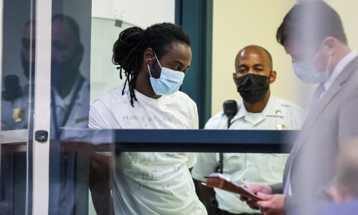 Conald Pierre is arraigned at the Malden District Court in Medford, Mass., on July 7, 2021. (Erin Clark/The Boston Globe via AP, Pool)
