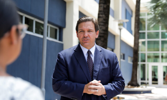 Florida Gov. Ron DeSantis departs after signing into law Senate Bill 7072 at Florida International University in Miami on May 24, 2021. (Samira Bouaou/The Epoch Times)