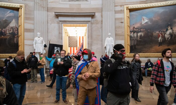 Protesters walk around in the Rotunda after breaching the U.S. Capitol in Washington on Jan. 6, 2021. (Saul Loeb/AFP via Getty Images)