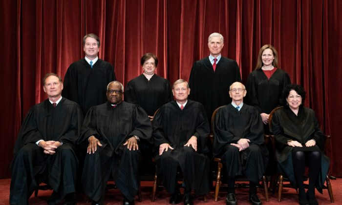 Members of the Supreme Court pose for a group photo at the Supreme Court in Washington, on April 23, 2021. Seated from left: Associate Justice Samuel Alito, Associate Justice Clarence Thomas, Chief Justice John Roberts, Associate Justice Stephen Breyer, and Associate Justice Sonia Sotomayor. Standing from left: Associate Justice Brett Kavanaugh, Associate Justice Elena Kagan, Associate Justice Neil Gorsuch, and Associate Justice Amy Coney Barrett. (Erin Schaff/Pool/Getty Images)