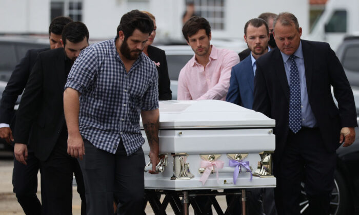 Pallbearers carry one of three caskets into the St. Joseph Catholic Church for the funeral of Anaely Rodriguez, her husband Marcus Guara, and their daughters  Lucia Guara, and Emma Guara at St. Joseph Catholic Church in Miami Beach, Fla., on July 6, 2021. (Joe Raedle/Getty Images)