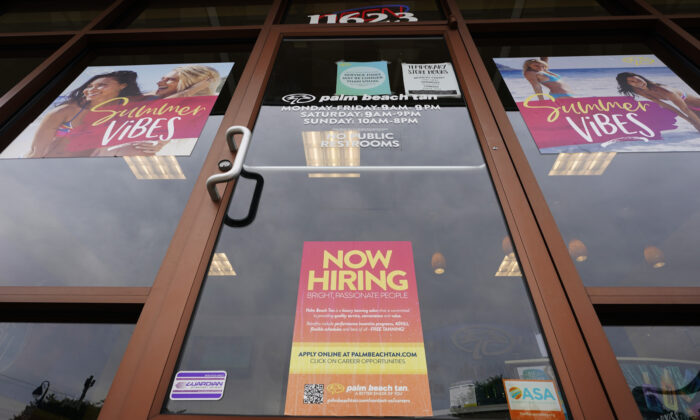 A Now Hiring sign is seen at a business in Richmond, Va., on June 2, 2021. (Steve Helber/AP Photo)