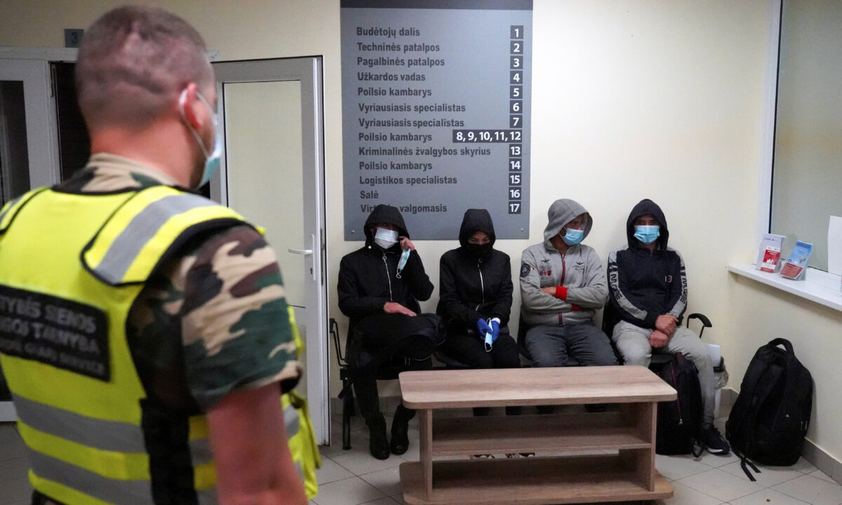 Lithuanian border guards detain migrants illegally crossing the border from Belarus to Lithuania, near Kalviai