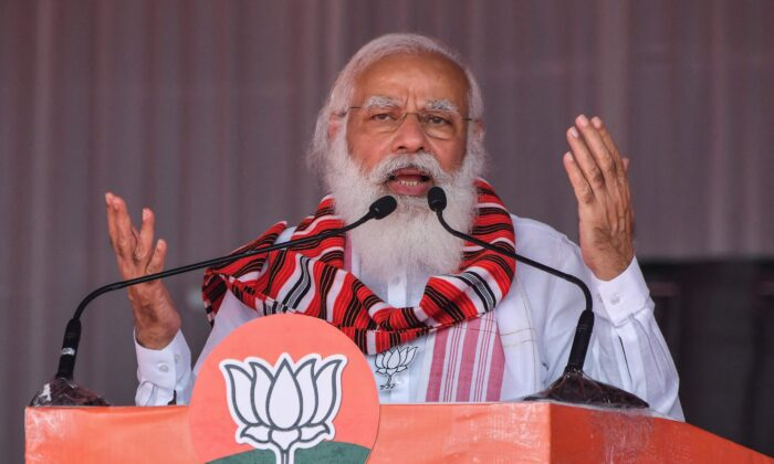 India's Prime Minister Narendra Modi gestures as he addresses a public meeting ahead of Assam Assembly elections, in Bokakhat, India, on March 21, 2021. (Biju Boro/AFP via Getty Images)