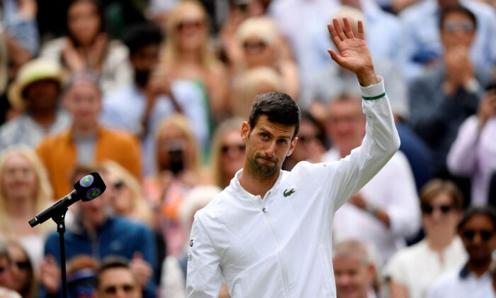 Serbia's Novak Djokovic during an interview after winning his quarterfinal match against Hungary's Marton Fucsovics at The Wimbledon Tennis Championships in London, UK on July 7, 2021. (Toby Melville/Reuters)