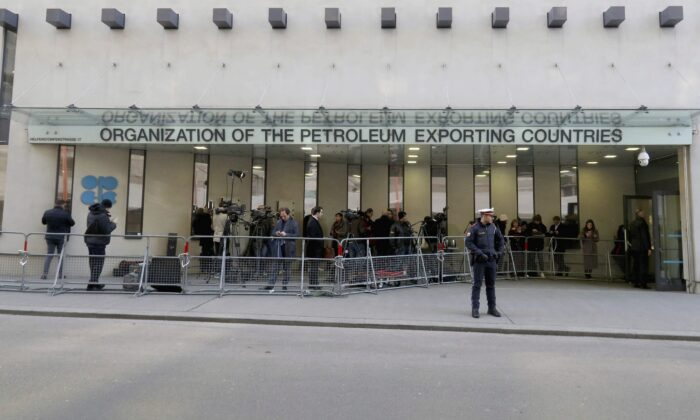 People stand in front of the Organization of the Petroleum Exporting Countries (OPEC) headquarters in Vienna, Austria, in a file photo. OPEC+ cancelled its July 5, 2021, meeting, leaving the oil market unsure of how supply will be regulated going forward. (AP Photo/Ronald Zak)