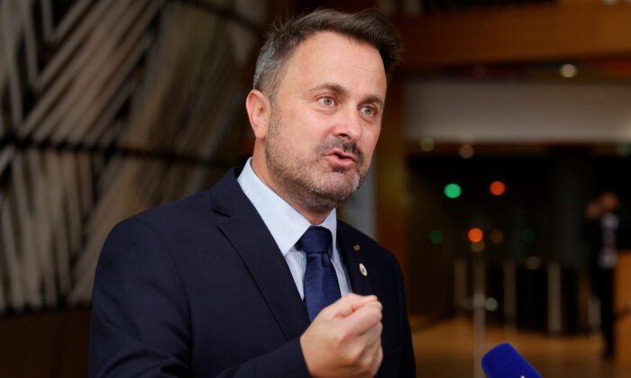 Luxembourg's Prime Minister Xavier Bettel talks to journalists as he arrives for the second day of a EU summit at the European Council building in Brussels, Belgium June 25, 2021. (Olivier Matthys/Pool via Reuters)
