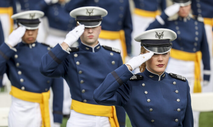 Members of the U.S. Air Force Academy Class of 2021 salute during their graduation ceremony at Falcon Stadium in Colorado Springs, Colo., on May 26, 2021. (Michael Ciaglo/Getty Images)