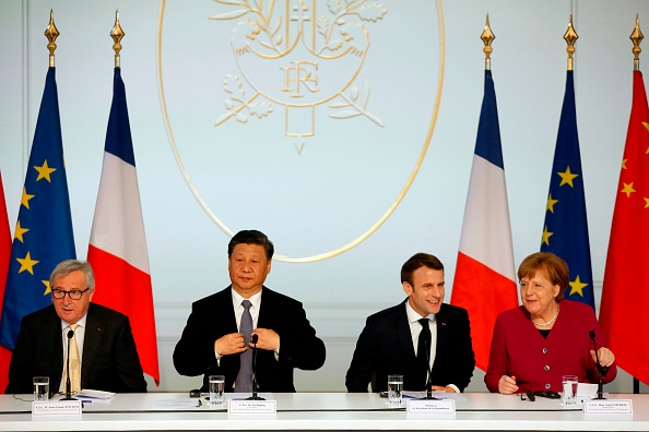 (From L) European Commission President Jean-Claude Juncker, Chinese President Xi Jinping, French President Emmanuel Macron, and German Chancellor Angela Merkel prepare to hold a press conference at the Elysee presidential palace in Paris, on March 26, 2019. (Thibault Camus/AFP via Getty Images)