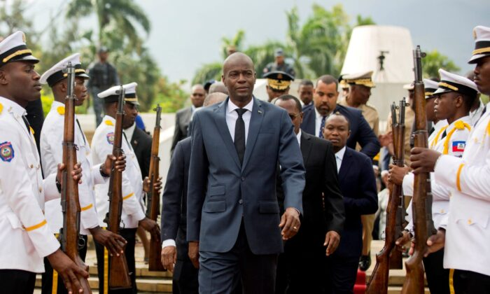 Haiti's President Jovenel Moise (C) leaves the museum during a ceremony marking the 215th anniversary of revolutionary hero Toussaint Louverture's death, at the National Pantheon museum in Port-au-Prince, Haiti, on April 7, 2018. (Dieu Nalio Chery/File/AP Photo)