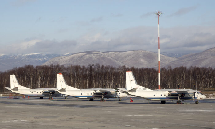 The Antonov An-26 with the same board number #RA-26085 as the missed plane is parked between two other Antonov An-26 planes at Airport Elizovo outside Petropavlovsk-Kamchatsky, Russia, on Nov. 17, 2020. (AP Photo/Marina Lystseva)
