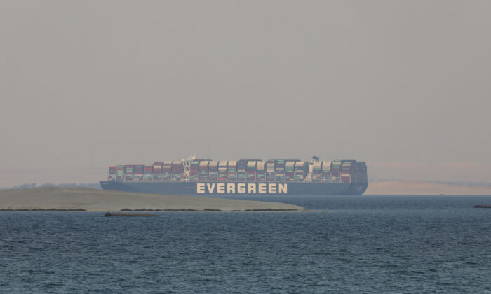 The Ever Given, a Panama-flagged cargo ship, is seen in Egypt's Great Bitter Lake, on March 30, 2021. (Mohamed Elshahed/AP Photo)