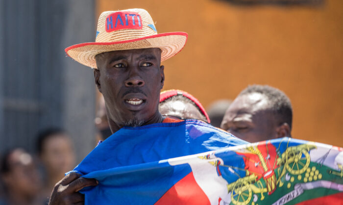 Haitians demonstrate during a protest to denounce the draft constitutional referendum carried by the President Jovenel Moise in Port-au-Prince on March 28, 2021. (Valerie Baeriswyl/AFP via Getty Images)
