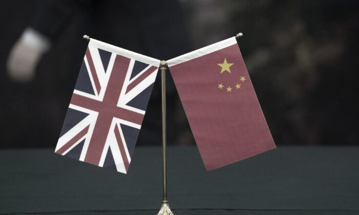 The union flag and the flag of the People's Republic of China, on March 2, 2015. (Arthur Edwards/The Sun/PA)