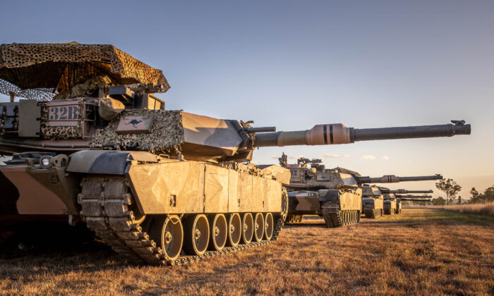Five Australian Army M1A1 Abrams tanks from the 2nd/14th Light Horse Regiment (Queensland Mounted Infantry) cast long shadows during Exercise Diamond Catalyst at Shoalwater Bay Training Area, Queensland. (TPR Jonathan Goedhart/ADF)