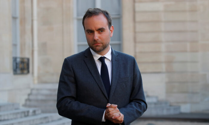 French Minister for Local Authorities Sebastien Lecornu delivers a statement after a videoconference with the French president and French mayors at the Elysee Palace in Paris on May 19, 2020. (Gonzalo Fuentes/Reuters)