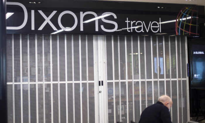 A Dixons Travel store with its shutters down at London City Airport on April 29, 2021. (Victoria Jones/PA)
